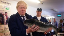 Boris Johnson MP visits Sam Cole Foods fish processing factory in Lowestoft, Suffolk.