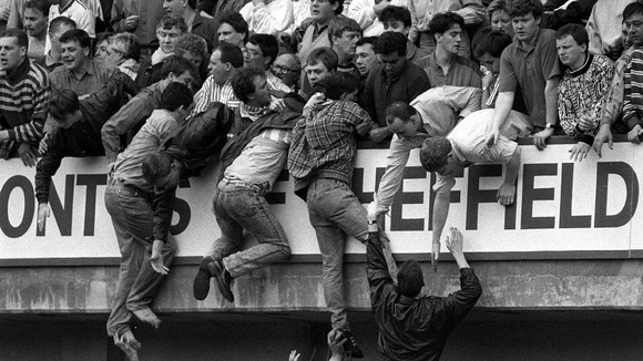 Liverpool fans trying to escape severe overcrowding during the 1989 FA Cup semi-final.