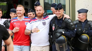 England football fans with French police outside Lille train station