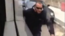 Video shows 'dangerous' cyclist holding onto tram