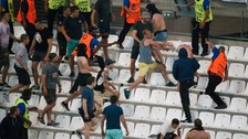Violence erupts in the stands following the match between Russia and England.