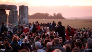 Crowds gather as dawn begins to break at Stonehenge, as thousands of people descended on the site to mark this year's summer solstice.