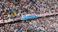 England fans watch as their team take on Wales.