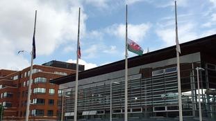 Flags flying half-mast outside the Senedd.