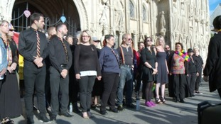 A choir sang in memory of the victims of the mass shooting.