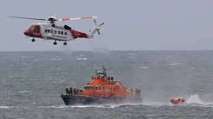 A coastguard search and rescue helicopter, based at Prestwick Airport and rescue boat