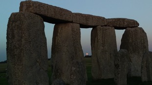 The moon seen through Stonehenge