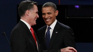 Barack Obama and Mitt Romney at the end of the first presidential debate