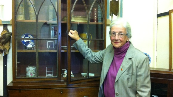 Shelagh Walker with empty cupboards