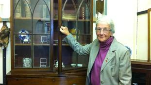 Shelagh Walker with empty cupboards