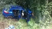 The car collided with another vehicle, and the central reservation, before hitting a tree