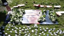 White roses laid at a tribute to Jo Cox
