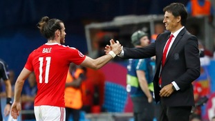 Gareth Bale celebrates with manager Chris Coleman