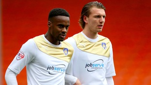 Alex Gilbey (right) has joined Wigan Athletic.