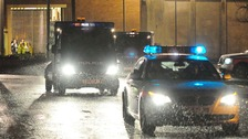 Police vehicles leave HMP Long Martin in Worcestershire