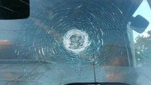 A van had it's windscreen damaged after stones were thrown at it from a bridge