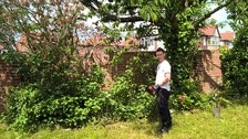 PC John Lorraine at work in the victim's garden.