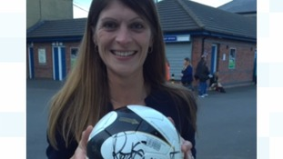 Eve Louden and her signed football