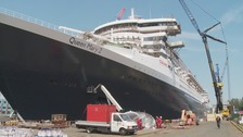 QM2 welcomed back into port