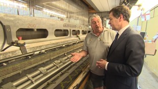 George Osborne is shown one of the looms at the carpet factory