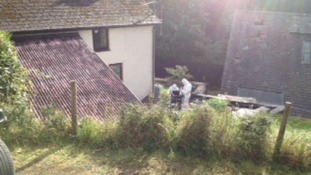 Forensic experts outside Mark Bridger's house in Machynlleth