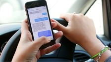 More than 100 motorists caught on their mobiles in a week