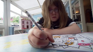 Emily colouring in one of the comics