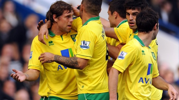 Grant Holt celebrates scoring the opener at Stamford Bridge