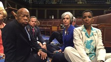 Democrats from the House and Senate stage a sit-in