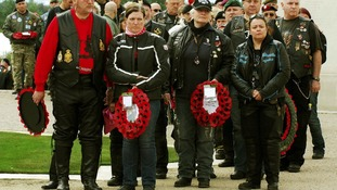 Bikers lay wreaths during the fifth annual Ride to the Wall at the National Memorial Arboretum, Alrewas, Staffordshire