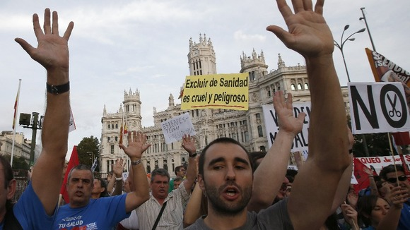Protesters take to the streets of the Spanish capital.