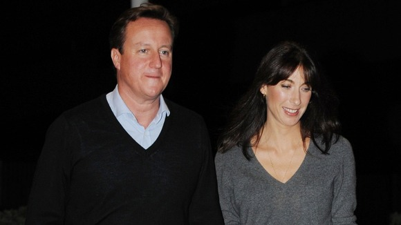David Cameron with his wife Samantha last night on the eve of the Conservative Party conference.