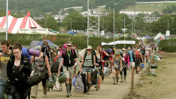 Festival goers leave Worthy Farm and the Glastonbury Festival in Somerset last year