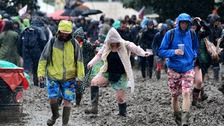 revellers in the mud at Glastonbury