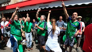 Norther Ireland fans mix with their Wales counterparts outside a Paris bar.