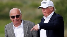 Donald Trump (left) with Rupert Murdoch at the Trump International Golf Links.