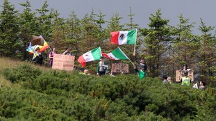 Protesters were seen waving Mexican flags by the course.