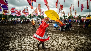 Festival-goers defy the mud on second day of Glastonbury