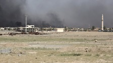 Smoke rises from clashes between the Iraq military and IS in Fallujah yesterday