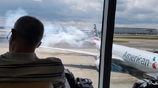American Airlines flight evacuated using emergency slides at London's Heathrow Airport