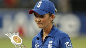 England&#x27;s captain Charlotte Edwards walks away with the runner&#x27;s up trophy after the ICC Women&#x27;s Twenty20 Cricket World Cup final match in Colombo, Sri Lanka, 