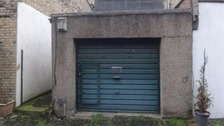Derelict north London garage on sale for £360,000.