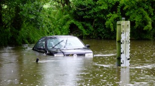 The VW is stranded in water up to the radiator grill