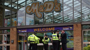 Police outside the theme park after Sunday's incident.