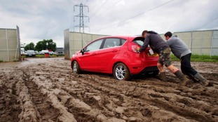 Festivalgoers struggle moving their cars from the carpark on the final day of the Glastonbury Festival, at Worthy Farm in Somerset.