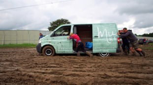 Revellers banded together to ensure cars and vans stuck in the mud could get out