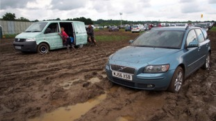 Constant rain and churned up mud meant many cars found themselves stuck in the carparks
