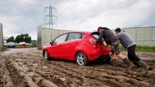 Mud leaves many stranded in Glastonbury's car parks