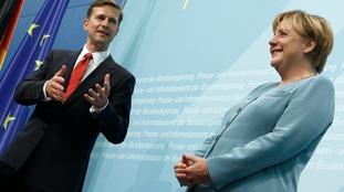 German government spokesman Steffen Seibert (L) pictured with Angela Merkel.