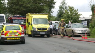 Four taken to hospital after garage fire in Norwich